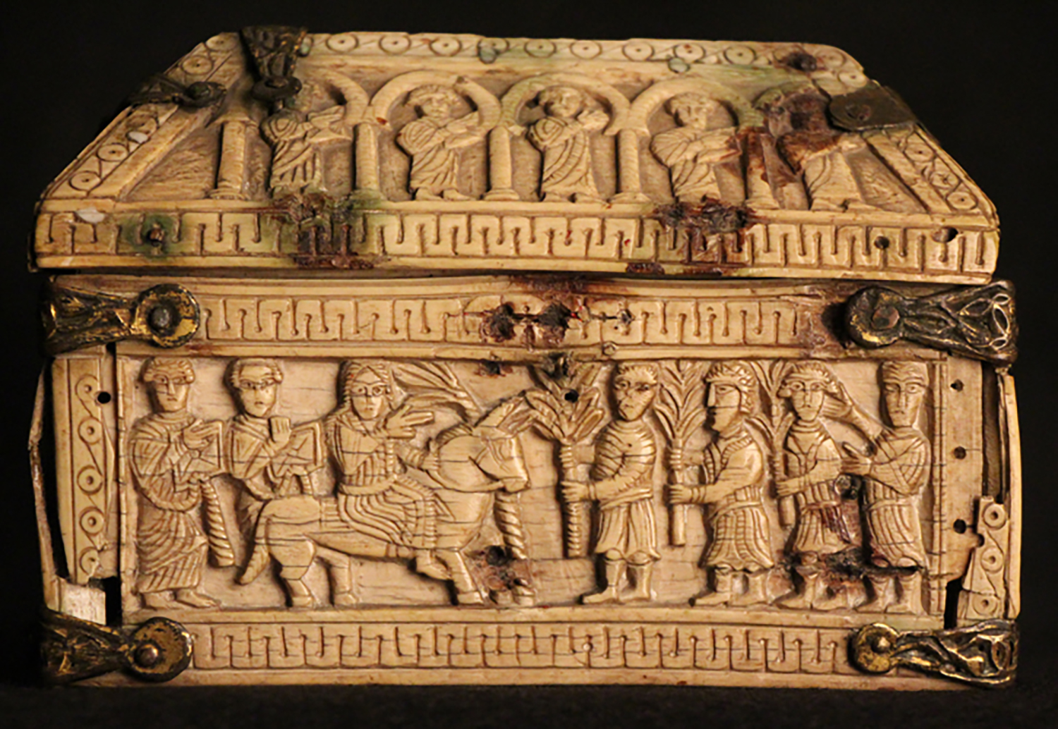 Figure 4: Scene on one of the long sides of the box depicting Solomon riding to Gihon to be anointed.He is greeted by men carrying palms.