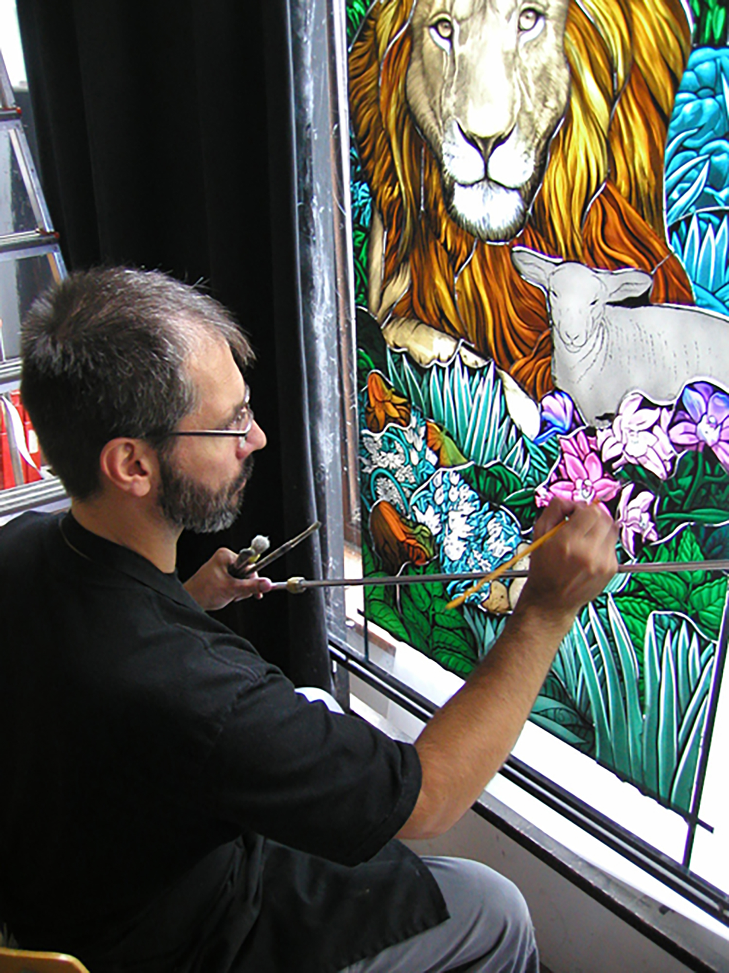 Figure 1: J. Kenneth Leap painting details on a stained glass panel.