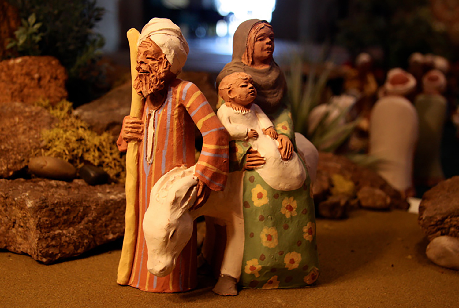 This terracotta figurine of the Flight into Egypt was made in a ceramic workshop in Cairo, along with a 12-piece Nativity set. The clothing styles are typical of rural Upper Egypt. The complete set, commissioned in 2010 by St. Mark's Coptic Museum in Toronto, Canada, can be seen in Glencairn's exhibition,  Follow the Star: World Nativities .