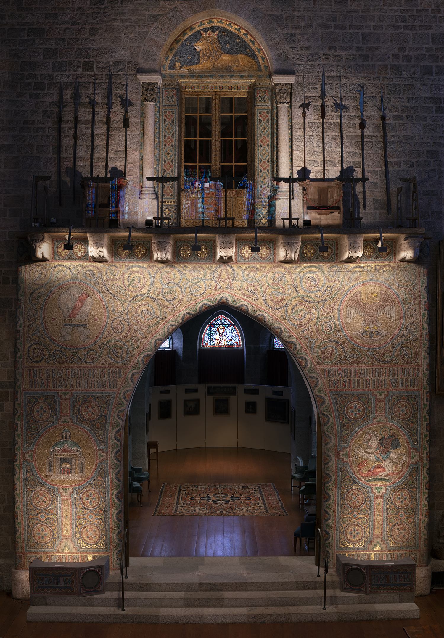Figure 1: The Great Hall of Glencairn features a monumental version of the Academy seal in glass mosaic. It reaches above the third floor balcony, culminating in a representation of a crowned lion with keys beneath his paws.