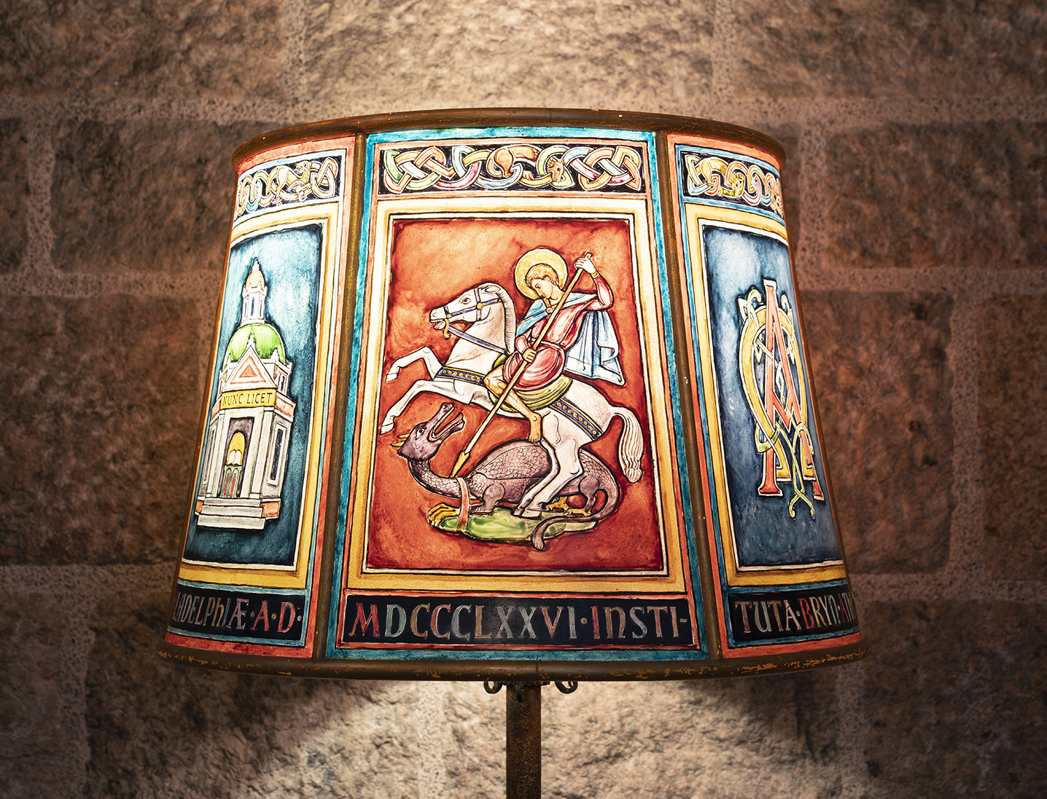 Figure 11: Artist Frank Snyder painted a six-sided Plexiglas lamp shade with the various elements of the Academy seal for Glencairn's Chapel.