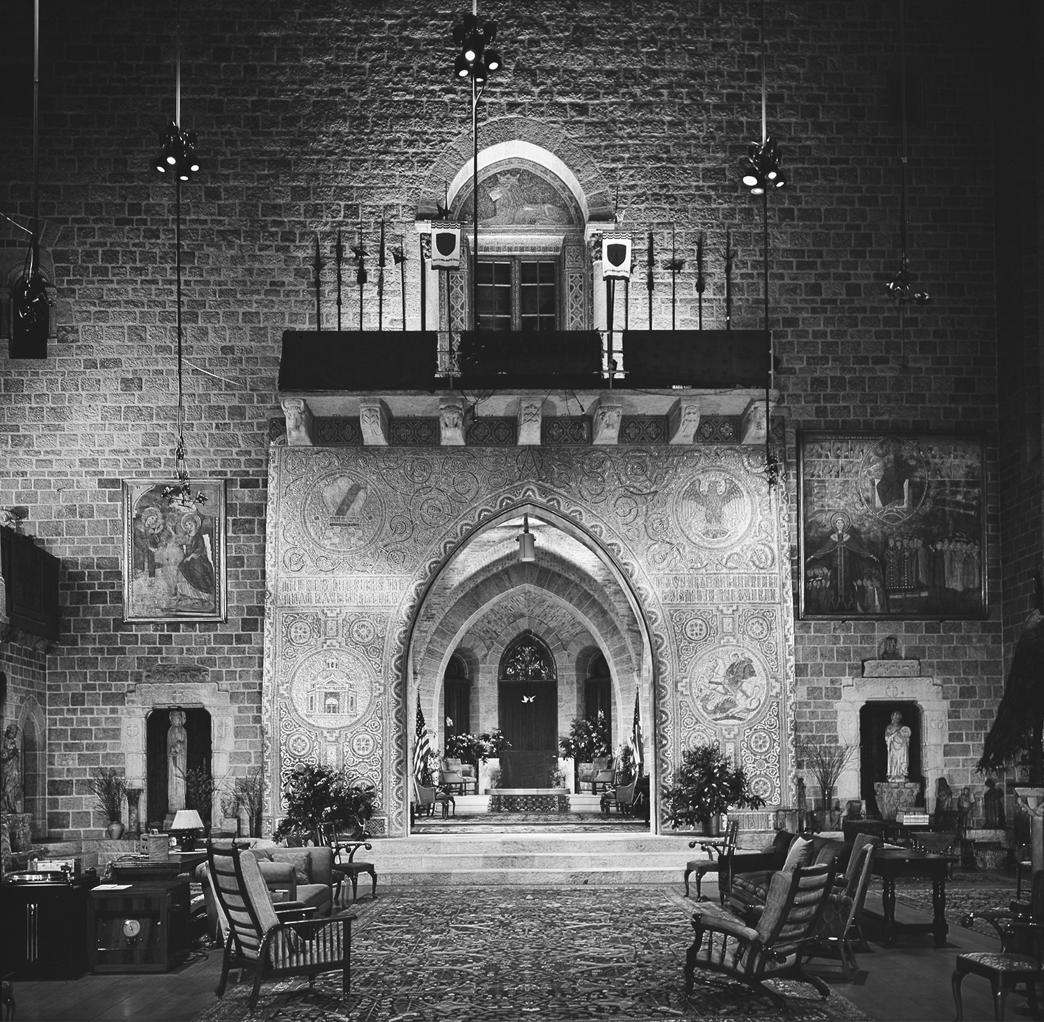 Figure 18: The Great Hall of Glencairn, with the large archway decorated with the Academy seal, sometimes served as a classroom. It was in this space that Raymond Pitcairn taught a series of music appreciation classes for college students. The room was equipped with a state-of-the-art sound system (lower left).