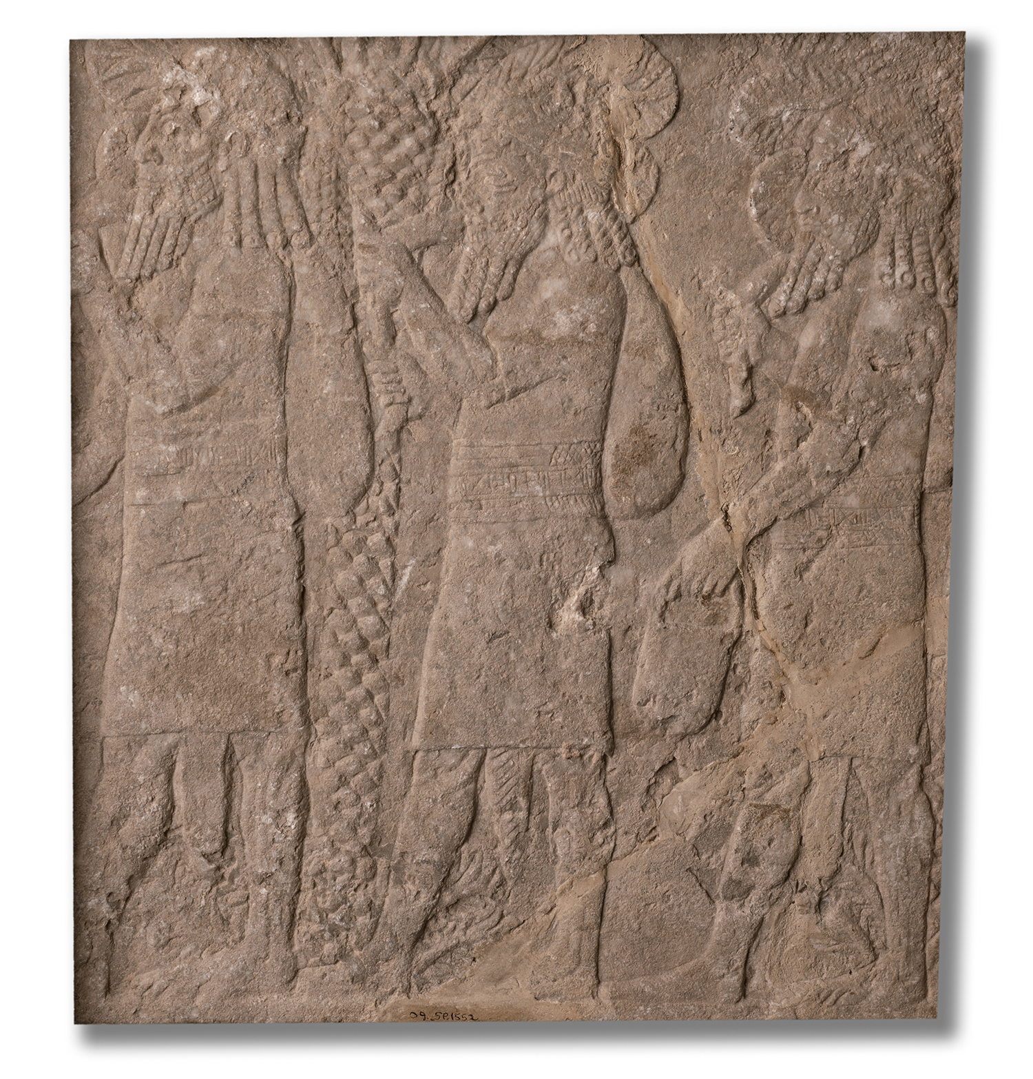 Figure 5: Gypseous limestone relief of Babylonian captives, from the courtyard of the North Palace of Ashurbanipal. Neo-Assyrian, seventh century BCE. In Glencairn's Ancient Near East gallery (09.SP.1552).