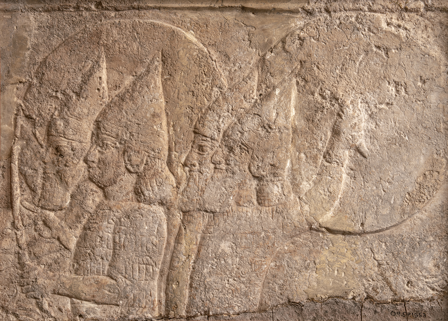 Figure 6: Gypseous limestone relief of soldiers in a chariot, from the North Palace of Ashurbanipal. Neo-Assyrian, seventh century BCE. In Glencairn's Ancient Near East gallery (09.SP.1552).