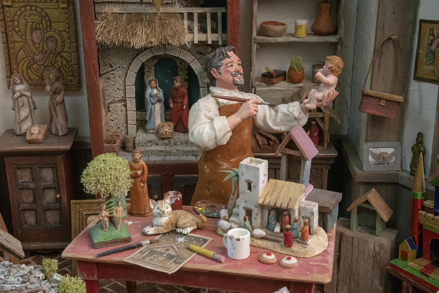 Figure 7: The Nativity artist featured in this scene, made by Karen Loccisano, bears a striking resemblance to her husband, R. Michael Palan.