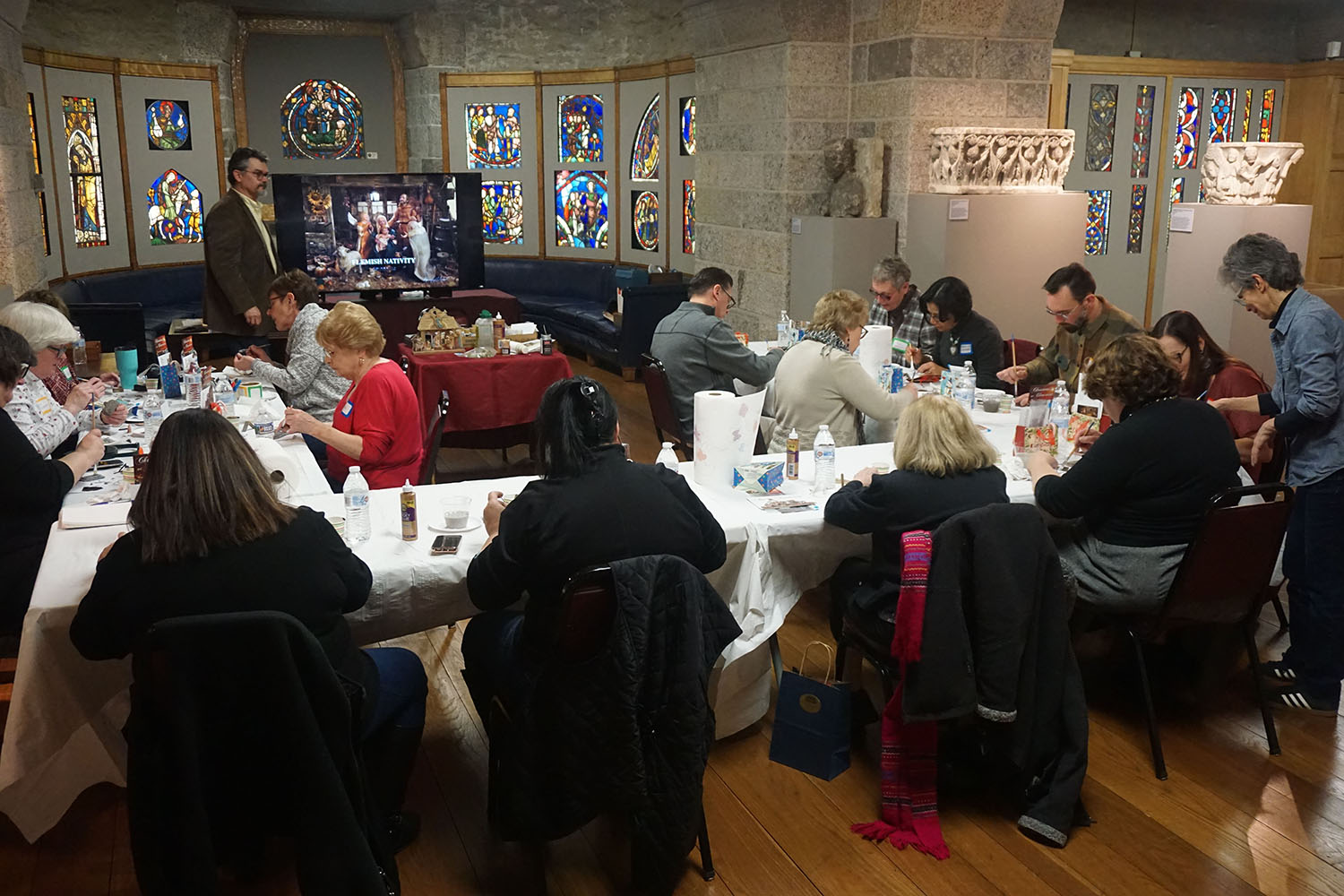 """Figure 21: A workshop being led by R. Michael Palan and Karen Loccisano in Glencairn's Medieval Gallery: """"The Art of Making Nativities."""""""