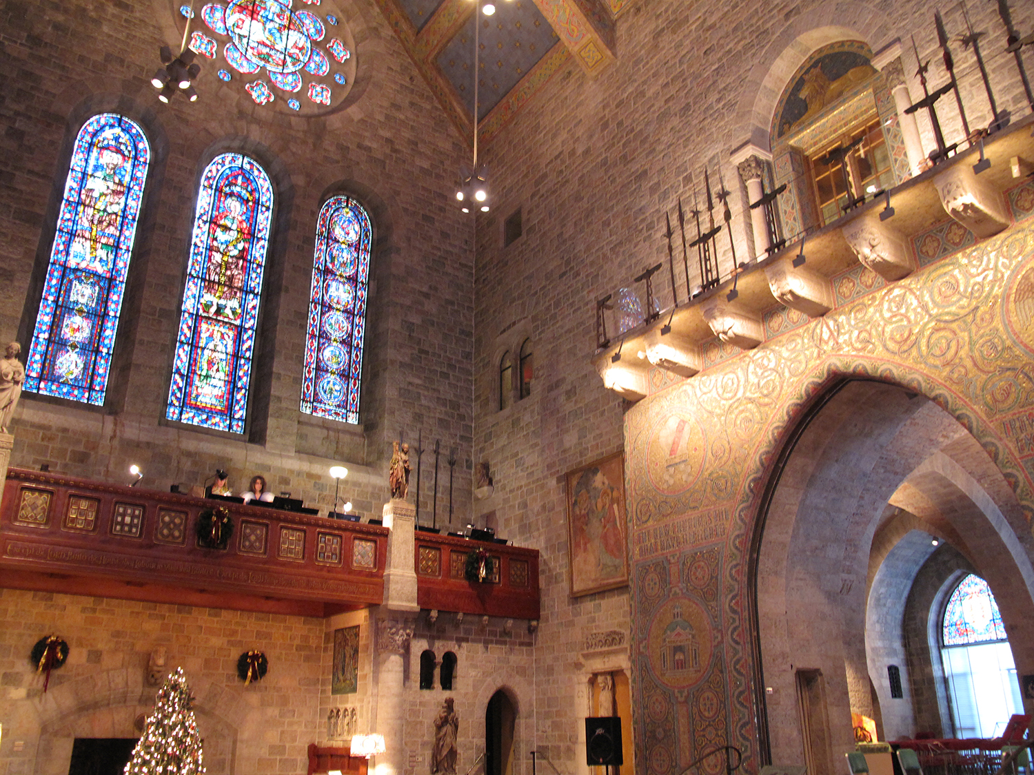 Figure 3: Medieval stained-glass window installation and mosaic arch, Great Hall, Glencairn Museum, Bryn Athyn, Pennsylvania. Photo: Jennifer Borland.