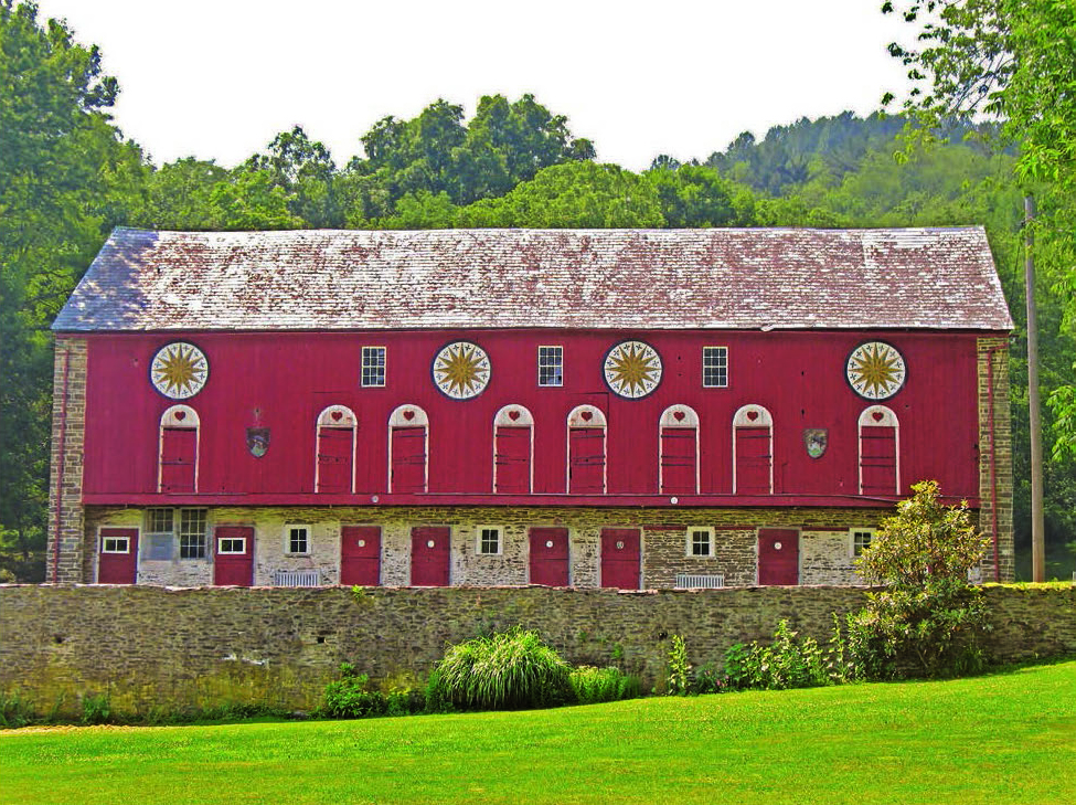 Figure 2: A Classic Decorated Pennsylvania Barn, Albany Township, Berks County, ca. 1850, courtesy of Patrick J. Donmoyer.  The barn standing at the location of the old Ida Bond Hotel was last painted in the 1980s by Johnny and Eric Claypoole of Lenhartsville, Berks County. The barn is a classic mid-nineteenth century Pennsylvania barn, featuring arches over the doors, and four twelve-pointed stars across the barn's forebay siding. No longer visible are three sets of arches over the windows, with three crosses within the arches.