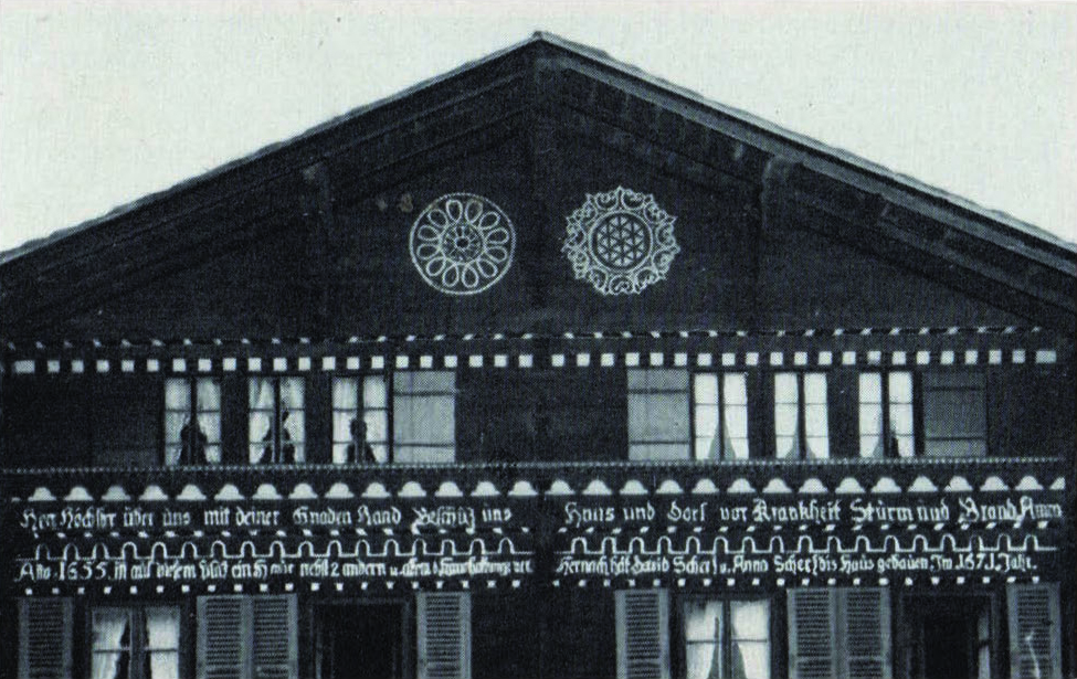 "Figure 15: The Blümlisalp Chalet, constructed in 1571, in Aeschi, Canton Solothurn in Switzerland. A decorated folk-house, it bears sunburst and rosette patterns, as well as running borders, and the following inscription: ""Highest Lord above us, with your graceful hand protect our house and village from sickness, storm, and fire, Amen."" And elsewhere on the same structure: ""It is not in the field nor in the trees, but it must germinate in the heart, if one is to become better."" From Gilfian Maurer,  Hausinschriften in Schweitzerland . Spiez: Verlag G. Maurer AG."
