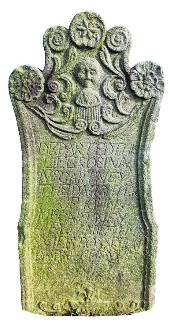"Figure 23: Early Gravestone of Rosina McGartney, Courtesy of Zion Evangelical Lutheran Church, Manheim, Lancaster County.  This intricately carved headstone reads: ""Departed this life, Rosina McGartney, the daughter of John McGartney & Elizabeth his wife, born and departed May 27, 1784."" This tragic inscription is now only partially legible, having been worn away by the elements over time."