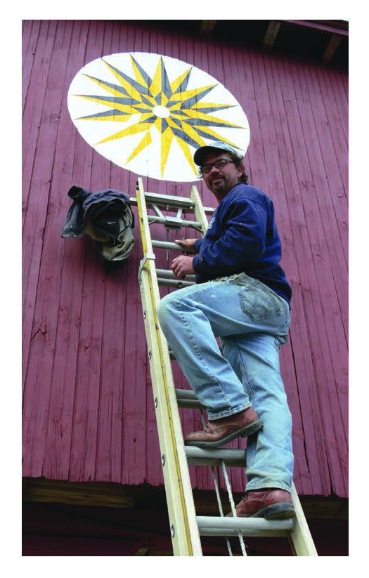 Figure 46: Second-generation barn star artist Eric Claypoole of Lenhartsville, the most prolific barn painter of the present time, who has painted over 75 barns during the course of his career. He started helping his father Johnny Claypoole (1921-2004) paint barns in 1972.