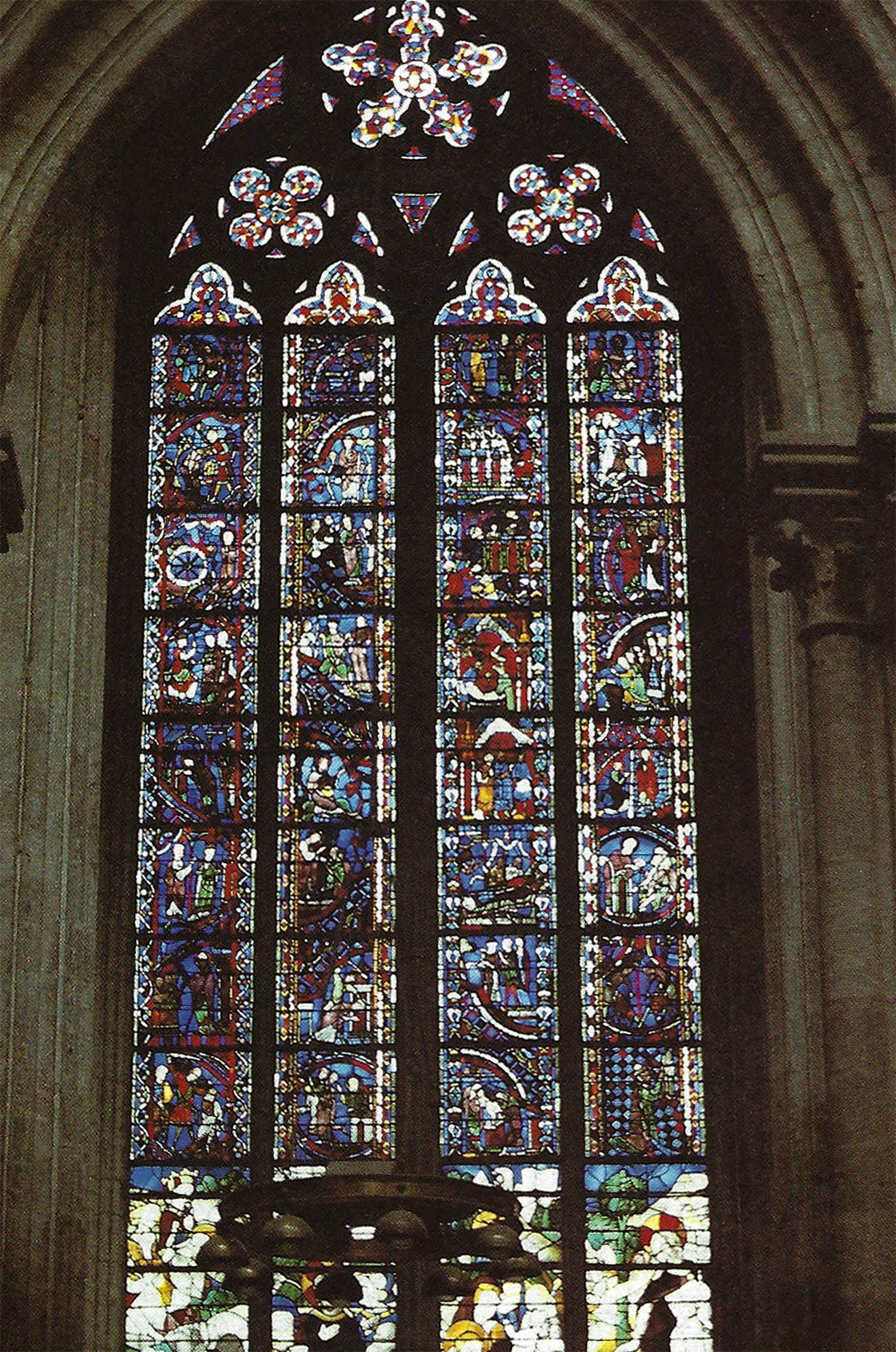 "Figure 5: View of ""Belle Verrière"" in the chapel of Saint-Jean-de-la-nef at Rouen Cathedral. Many of the panels installed in the upper lancets originate from the broad early thirteenth-century windows of the nave aisle."