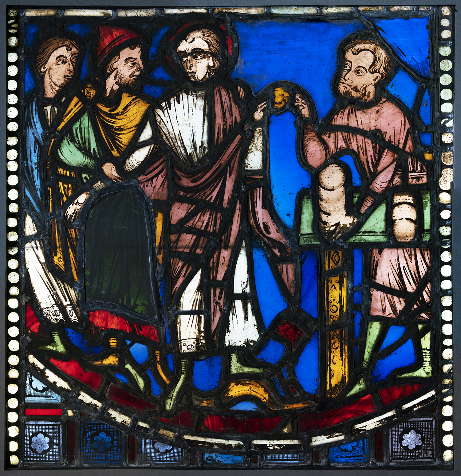 Figure 7: Malchus is seized while trying to buy bread with an antique coin, from the Seven Sleepers of Ephesus window of the nave aisle of Rouen Cathedral, c. 1200-1203, now in Glencairn Museum (03.SG.49).