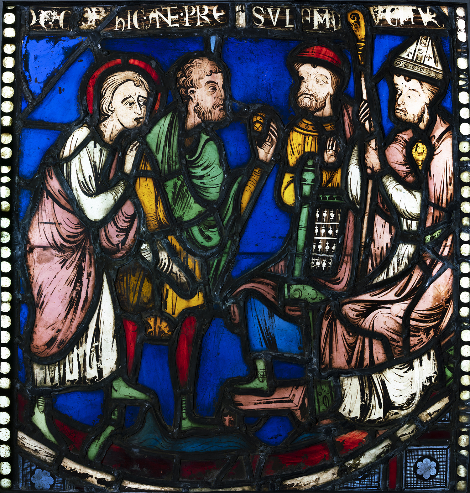 "Figure 8: Malchus is led before the bishop and prefect ("" hic ante presulum ducitur ""), from the Seven Sleepers of Ephesus window of the nave aisle of Rouen Cathedral, c. 1200-1203, now in Glencairn Museum (03.SG.51)."
