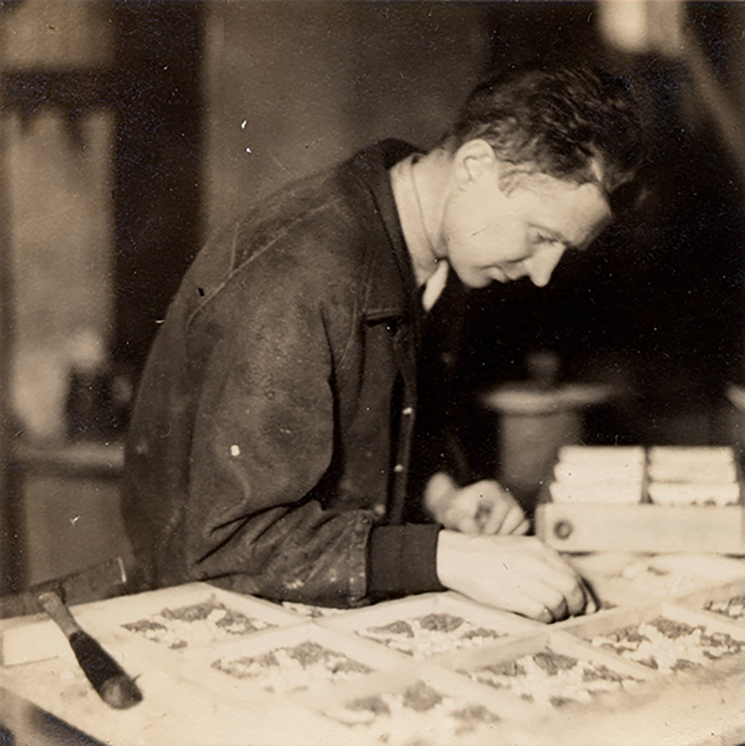 Figure 6: Samuel Croft II assembling mosaic stars for the ceiling of the Great Hall.