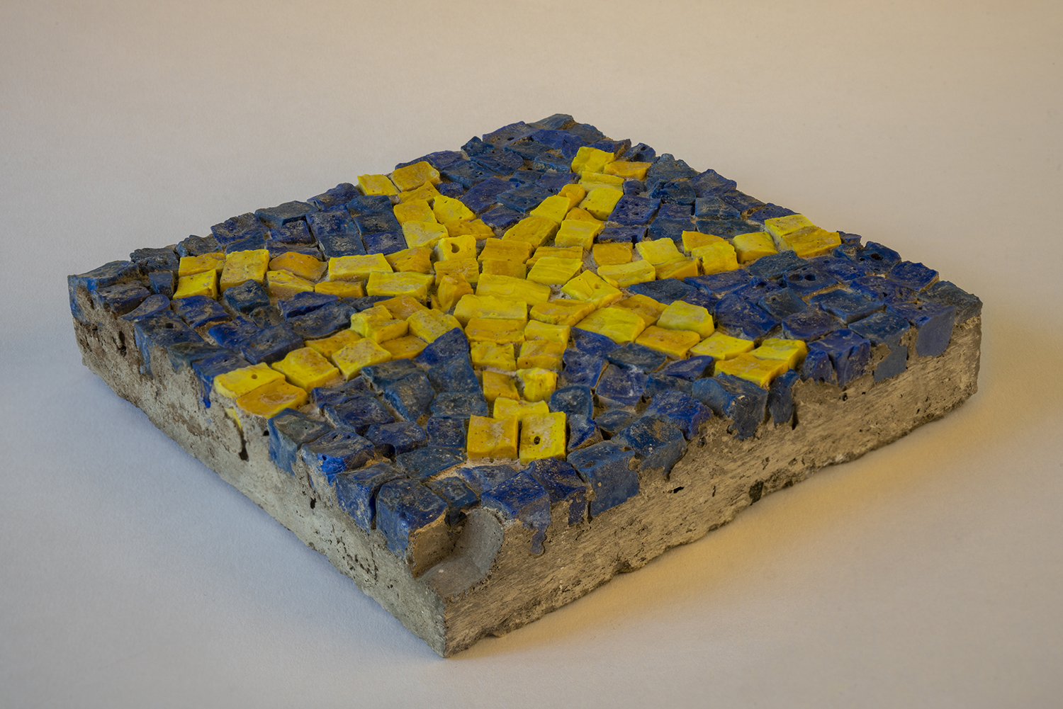 Figure 9: Glass tesserae were glued to a sheet of heavy paper, then then turned upside down and pressed into wet cement.