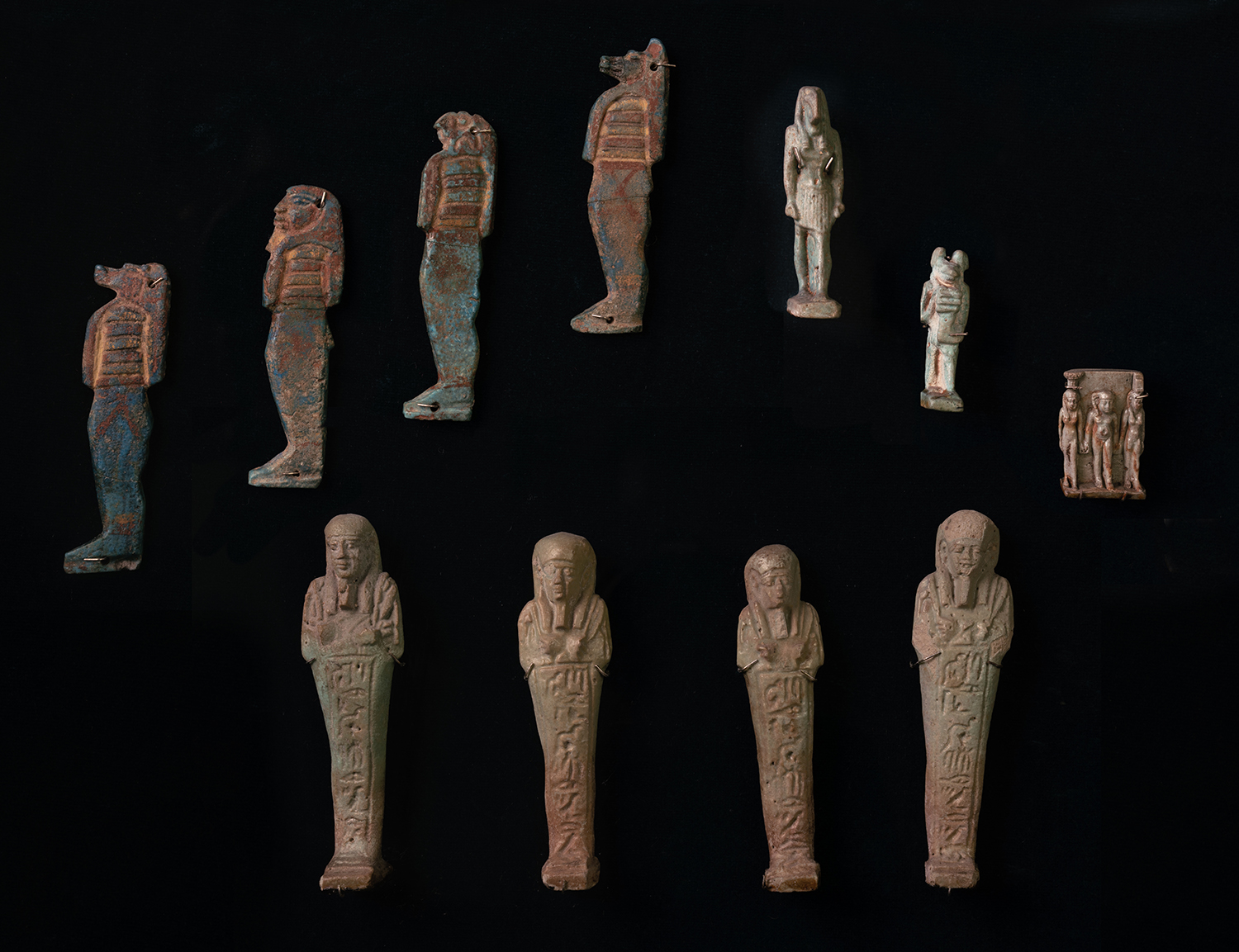 Figure 2: Some objects buried in the tomb had been used by the deceased during life, but other tomb goods like shabtis, canopic jars, and certain amulets were made specifically for the burial.