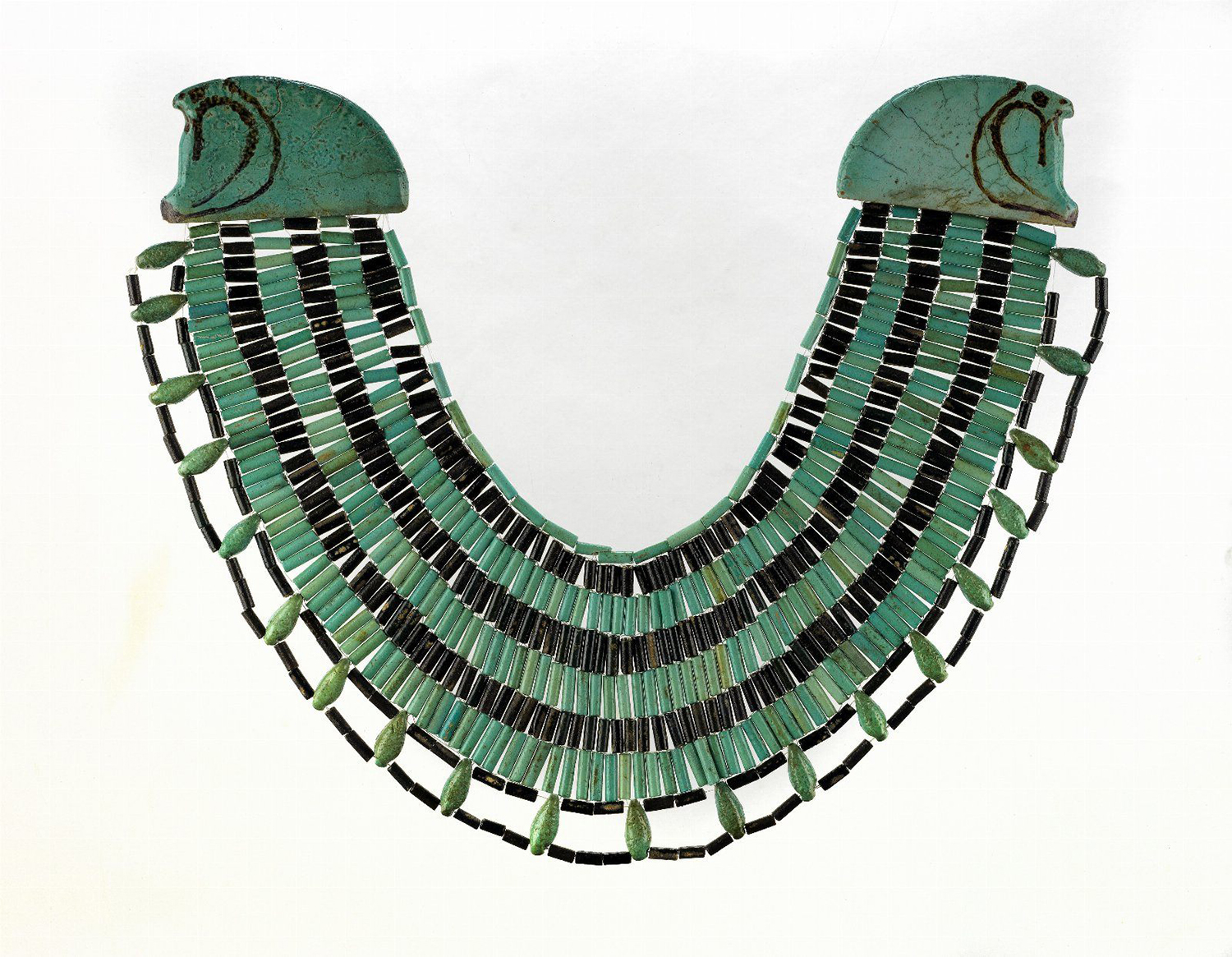 Figure 10:  Wesekh  collars were popular pieces of jewelry in ancient Egypt, worn by both men and women. This example, comprised of faience beads, was excavated at the site of Meydum. It dates to Egypt's Middle Kingdom (1980-1630 BCE). Image courtesy of the University of Pennsylvania Museum of Archaeology and Anthropology, accession number 31-27-303.