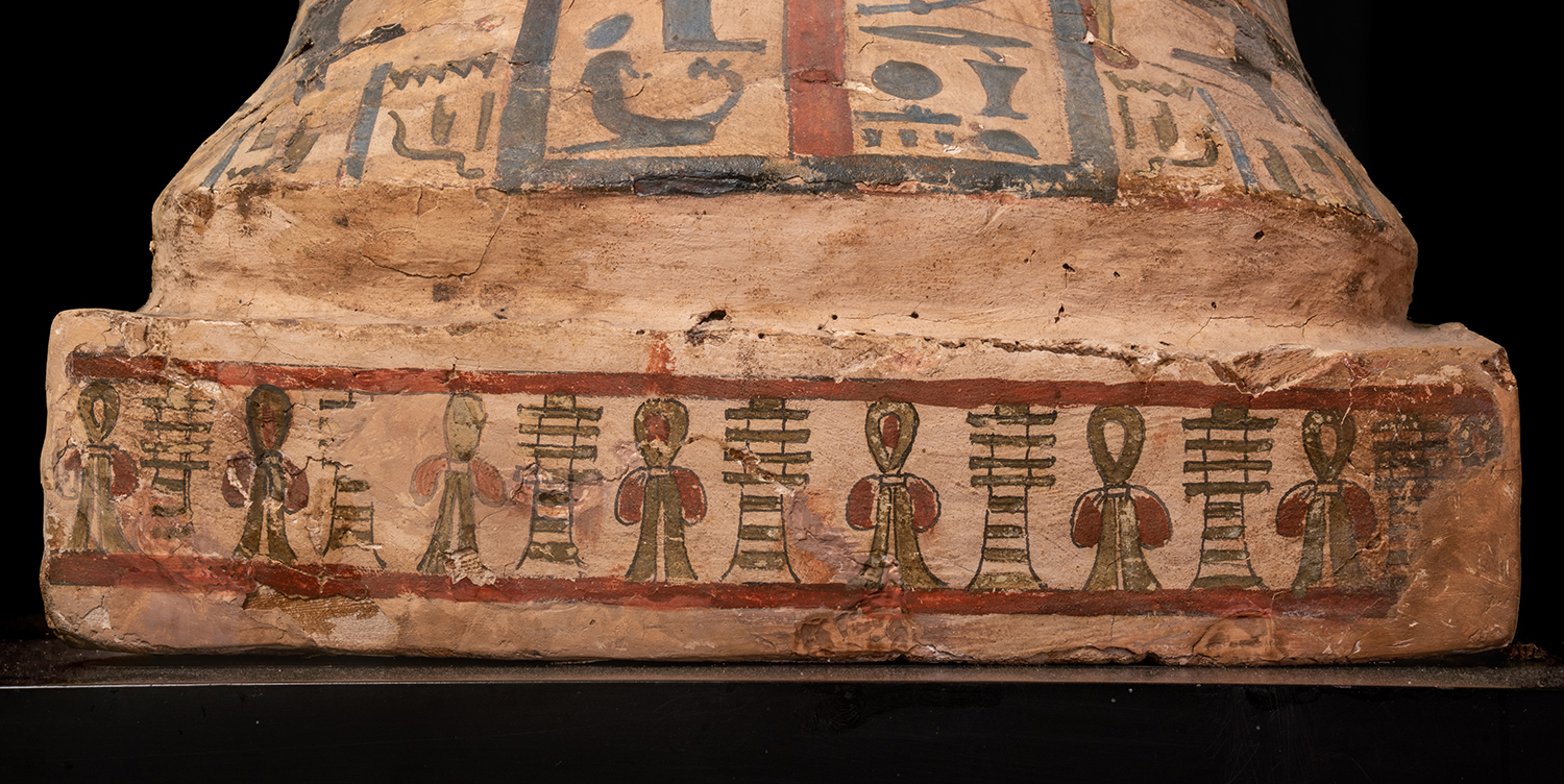 "Figure 19: A frieze of alternating  djed  pillars (""stability"") and  ankh s (""life"") decorate the small podium at the foot of the coffin lid."