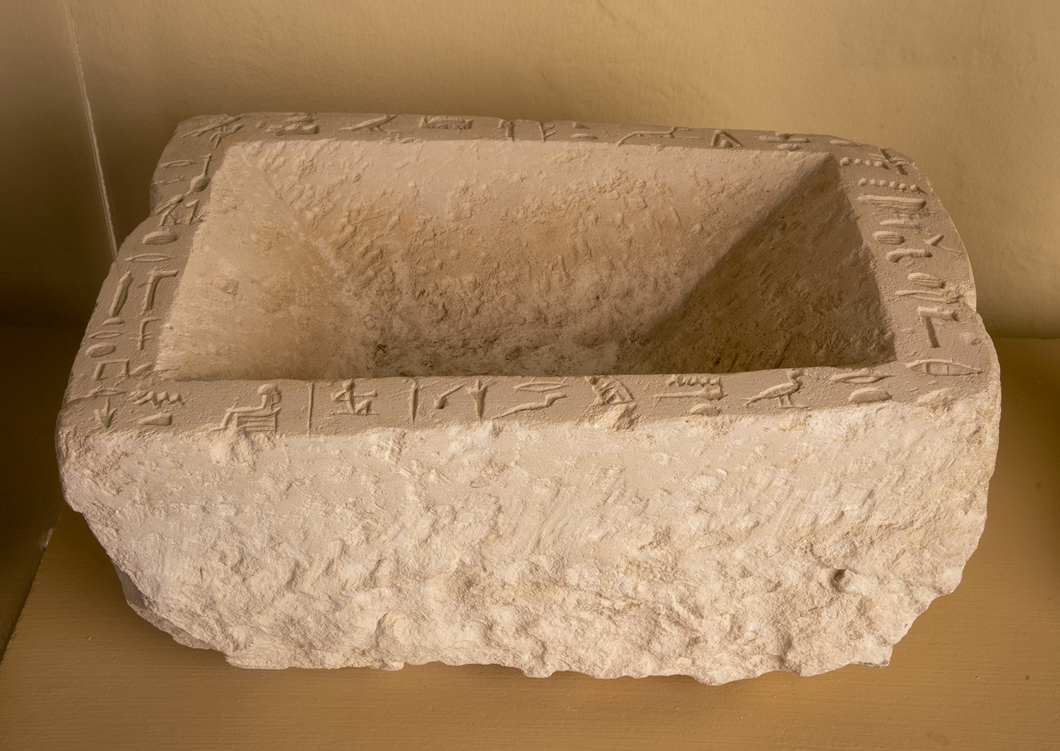Figure 24: Limestone offering basin of Per-senet from her tomb at Giza, in Glencairn's Egyptian Gallery. This basin is on loan from the University of Pennsylvania Museum of Archaeology and Anthropology, accession number E13526.