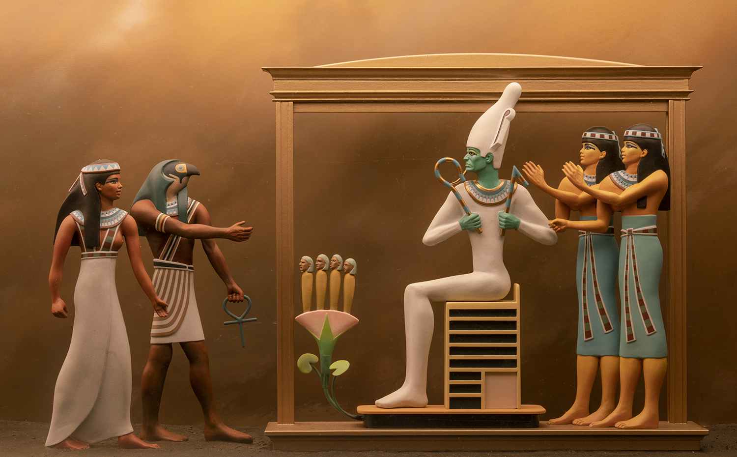 Figure 29: In this scene from a diorama on exhibit in the Egyptian Gallery at Glencairn, the deceased, a woman named Isty, is shown being ushered in before Osiris after passing successfully into the afterlife. This diorama is based on a  Book of the Dead  funerary papyrus now in the collection of the Field Museum in Chicago.