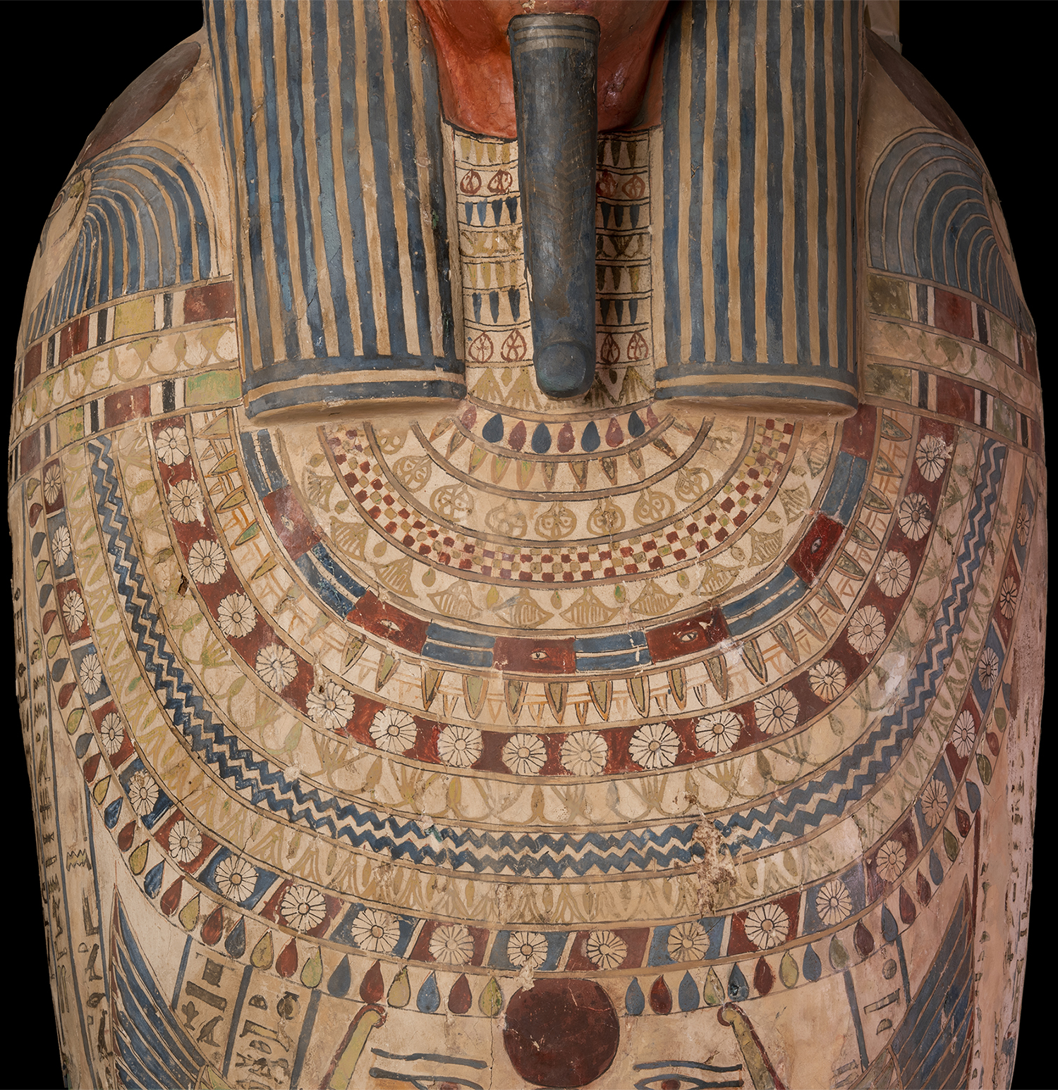 Figure 9: The area of the chest is covered by a large multi-color  wesekh  collar.
