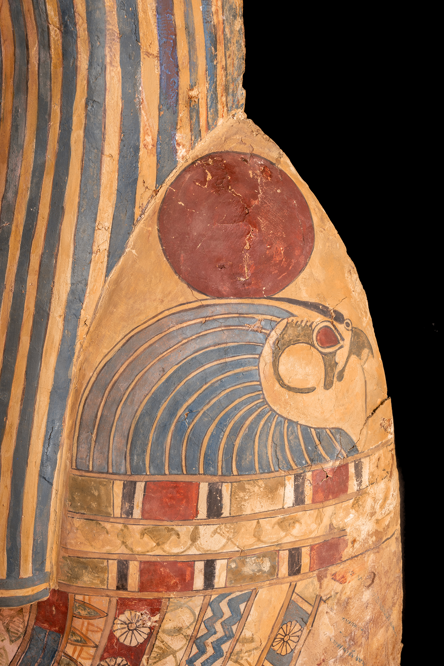 Figure 11: Close-up of one of the falcon-headed collar terminals on the coffin of Sema-tawy-iirdis.