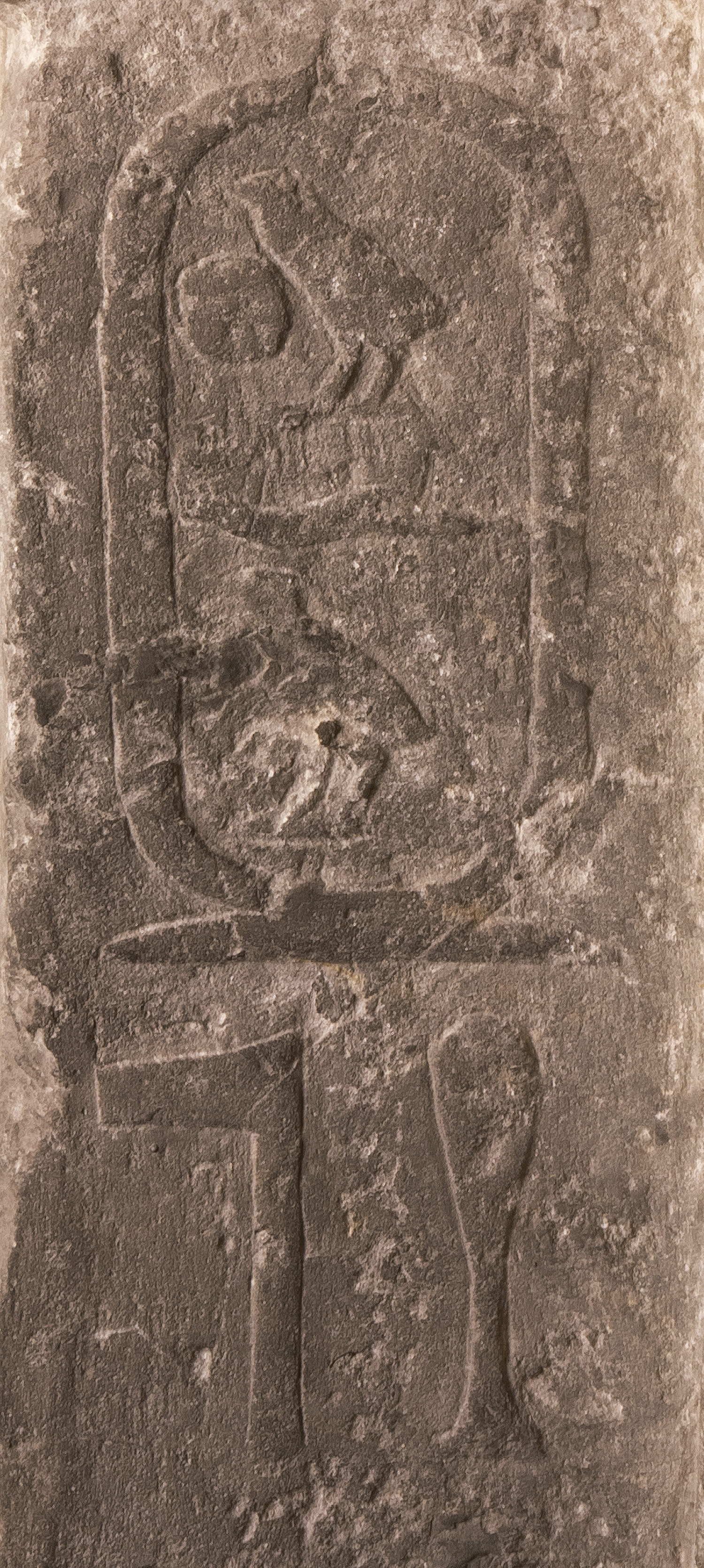 "Figure 23: A closeup of the text on the false door of Tepemankh showing the cartouche of King Khufu as part of Tepemankh's title:  hem-netcher Khufu  (""Priest of Khufu"")."