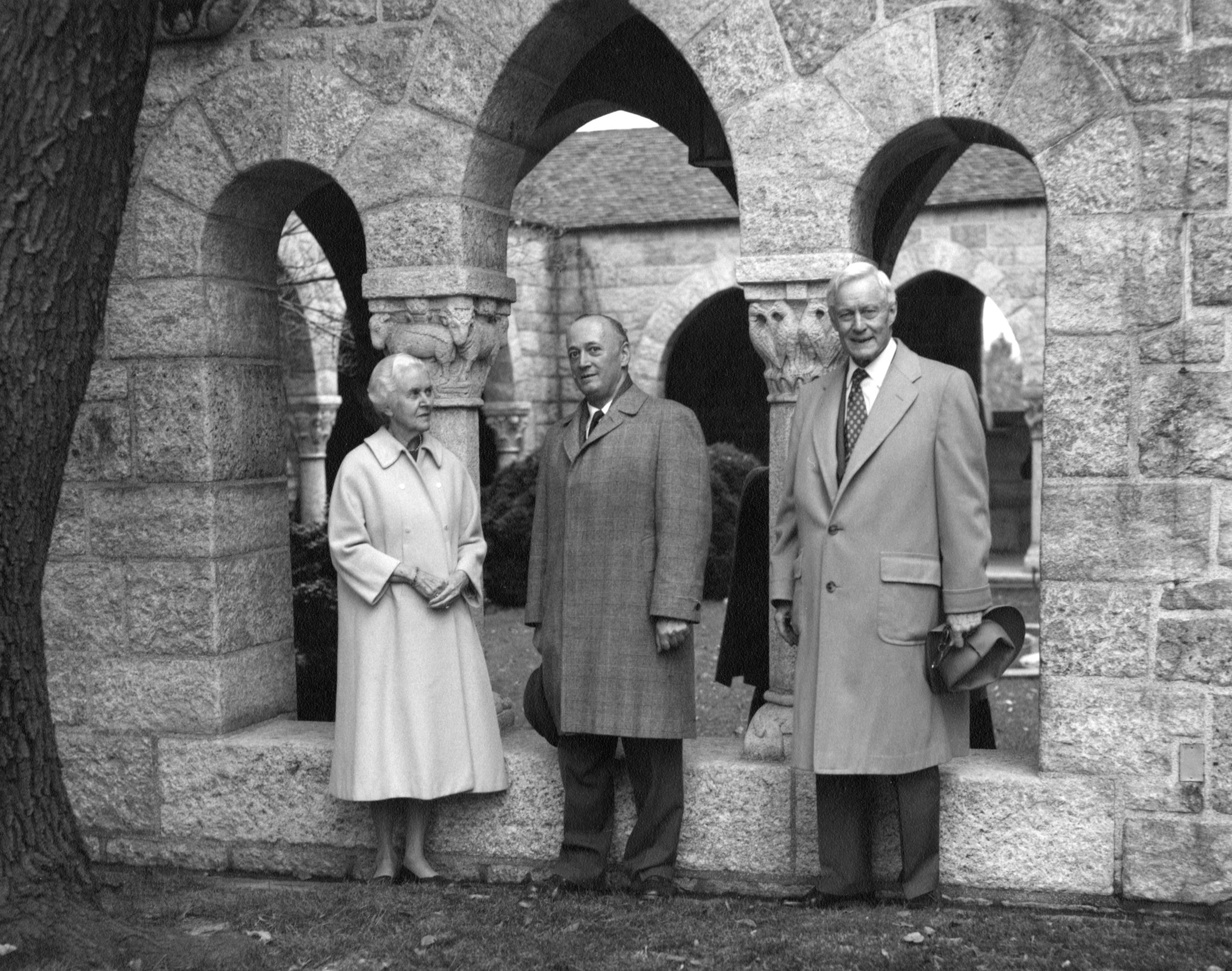 James Rorimer stands between Mildred and Raymond Pitcairn outside of Glencairn's cloister on November 11, 1965. Rorimer, then-director of The Metropolitan Museum of Art in New York City, spent the day at Glencairn together with members of The Cloisters staff. The visit and house tour was captured on audio tape.