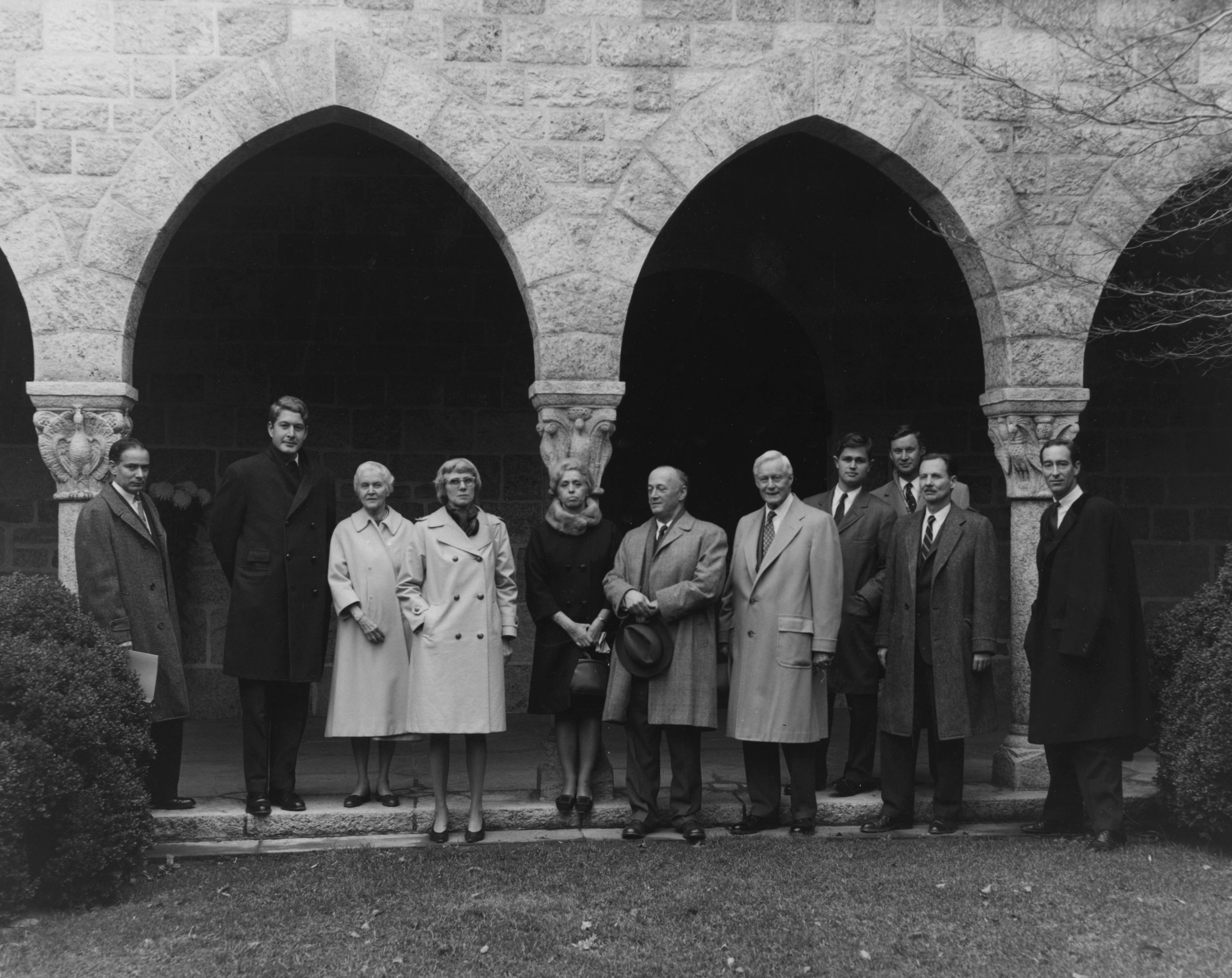 Figure 1: A photograph of the group in Glencairn's cloister: (l-r) E. Bruce Glenn, Thomas P. Miller, Mildred Pitcairn, Bonnie Young, Carmen Gómez-Moreno, James Rorimer, Raymond Pitcairn, Harry Parker III, Lachlan Pitcairn (slightly behind), William H. Forsyth, and Thomas Hoving. Photograph by Michael Pitcairn.