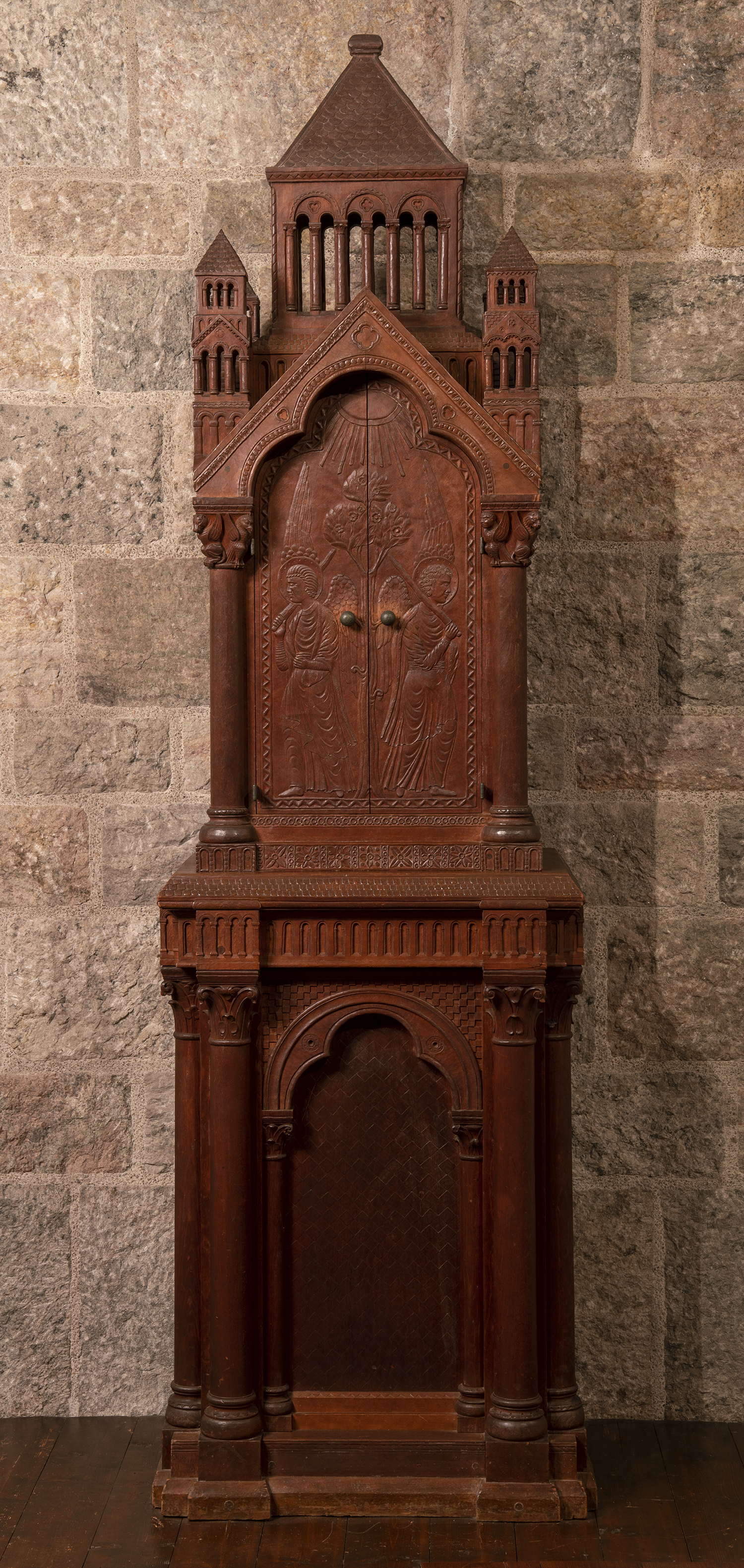 Figure 2: Raymond Pitcairn directed Frank Jeck to carve this Bible cabinet for use in the family's chapel around the year 1926, before construction had begun on Glencairn. The biblical imagery on the cabinet is repeated elsewhere in the chapel in stone and glass mosaic.