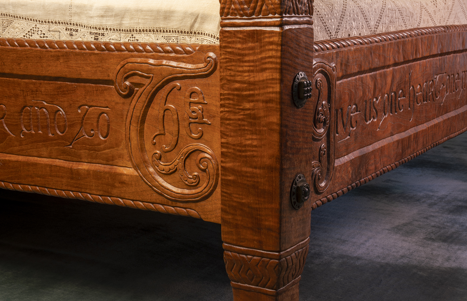 Figure 19: A corner of the master bed showing the intricate carving of the quotation around three sides.