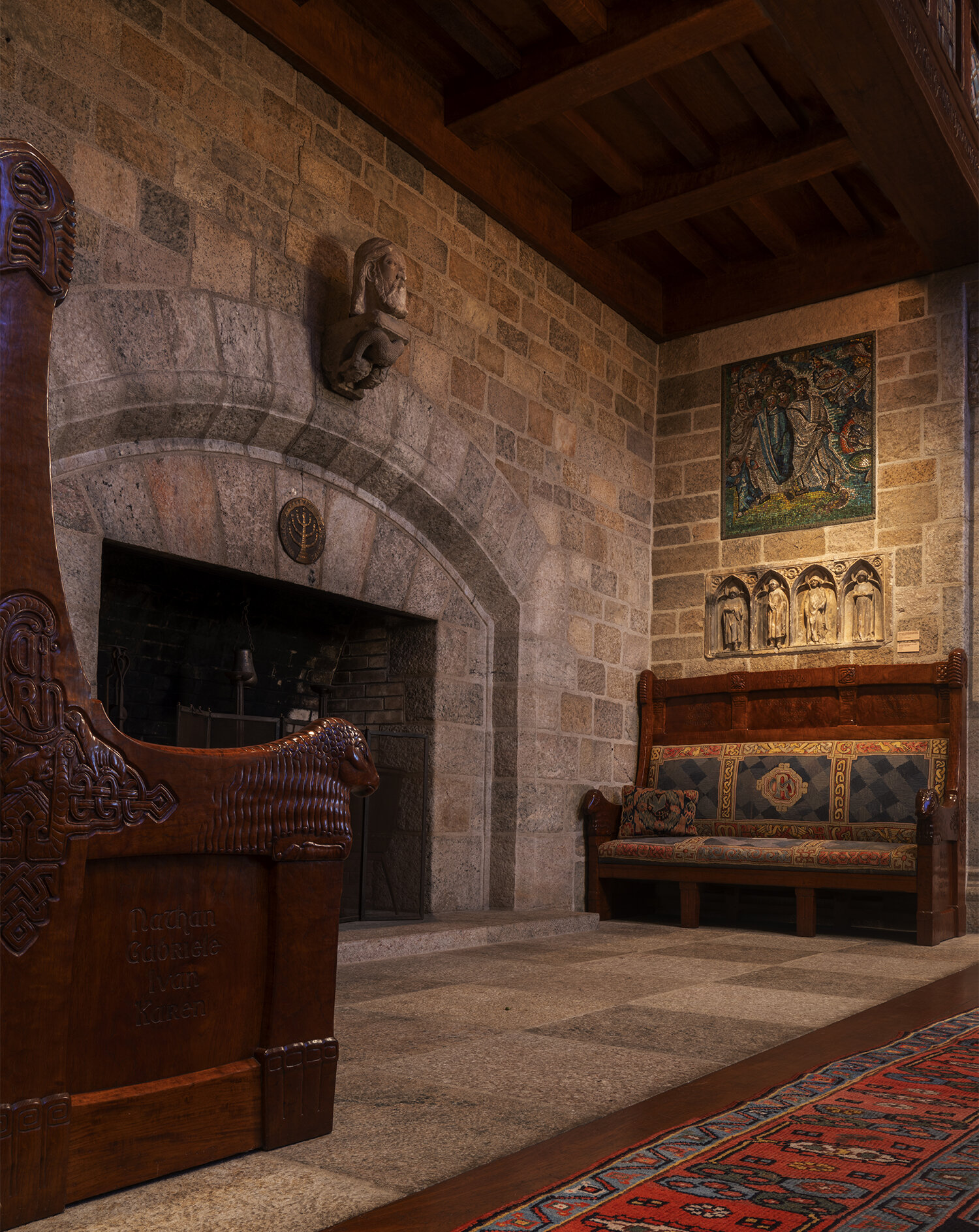 Figure 8: Two benches carved by Frank Jeck illustrating the uniting of Raymond and Mildred's families through marriage were made for the inglenook in Glencairn's Great Hall.