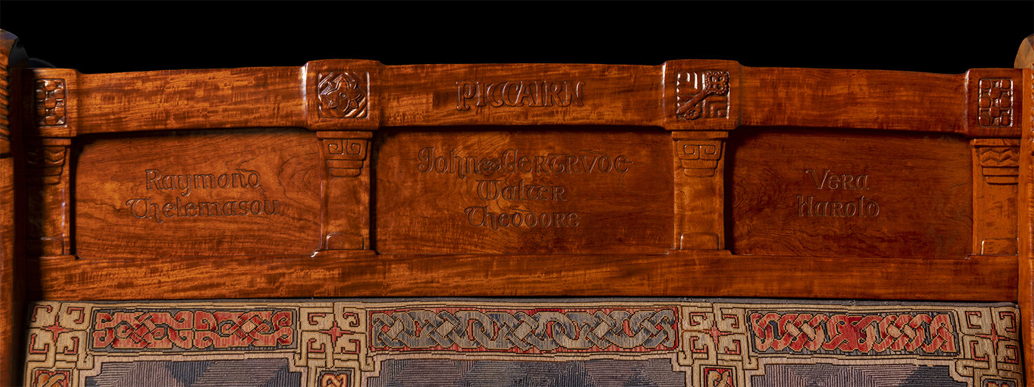 Figure 11: The names of Raymond Pitcairn's parents and siblings are carved into the backrest of the left-hand bench.