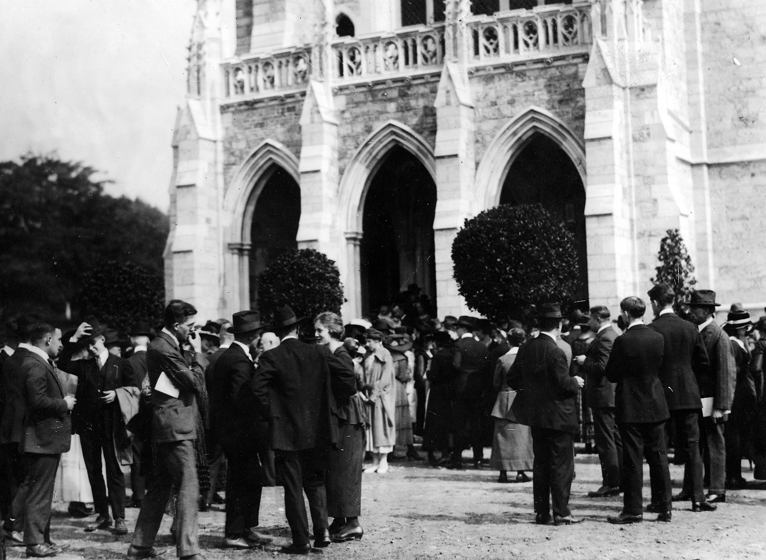 Figure 10: People mingling outside the west door of the Cathedral on October 5, 1919.