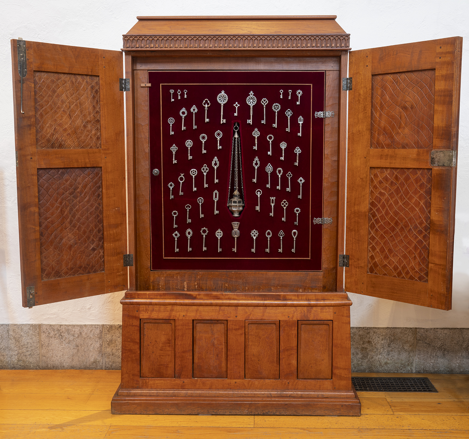 """Figure 6: The key cabinet in Bryn Athyn Cathedral. Each of the keys is unique, illustrating a design principle that was employed throughout the Cathedral. In 1920 Raymond Pitcairn delivered a speech titled, """"Christian Art and Architecture in the New Church."""" In it he describes """"the perfection of variety"""" in which """"all things conspire to one end"""" ( New Church Life  1920: 618)."""