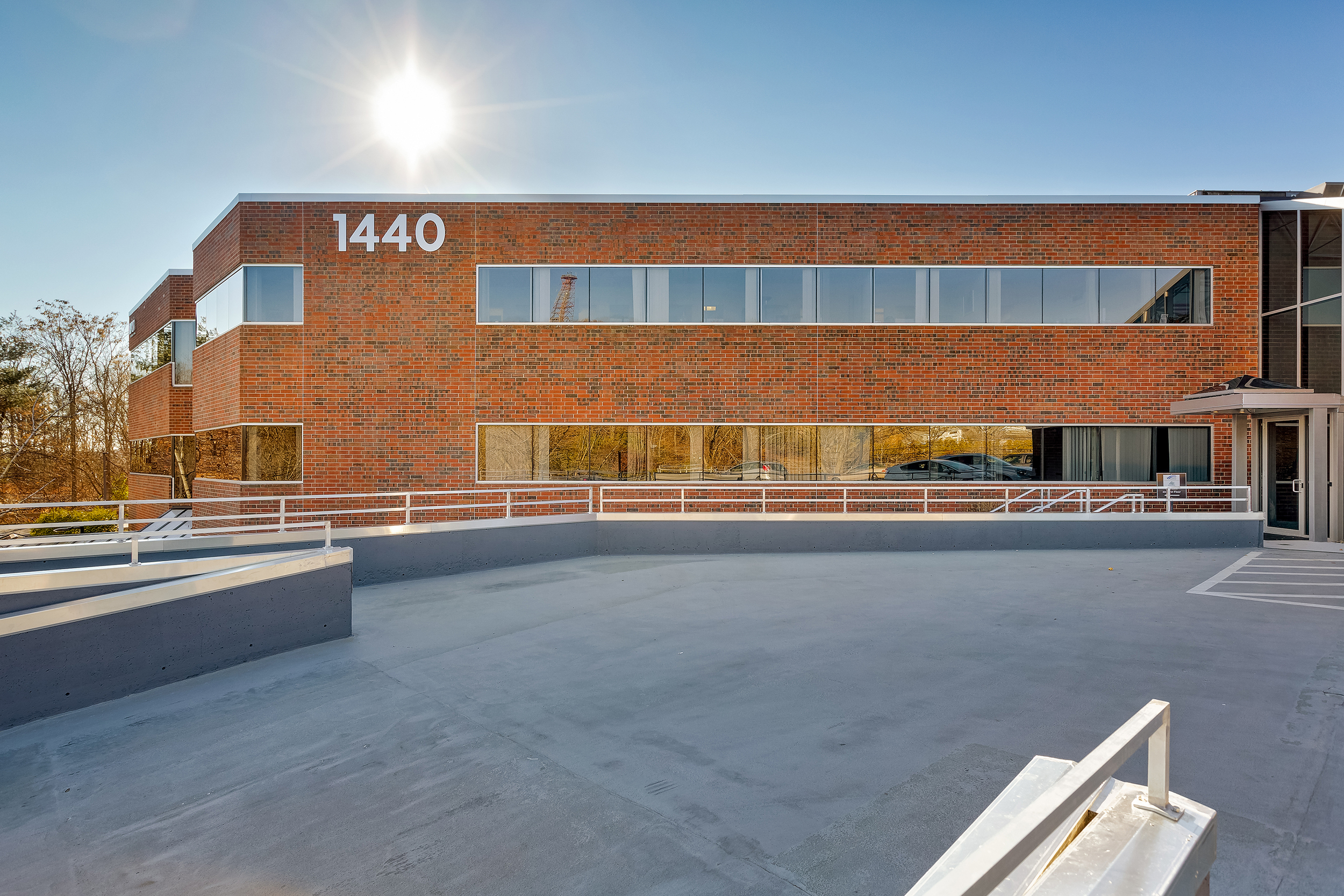 New window line and complementing parking deck modernized railings