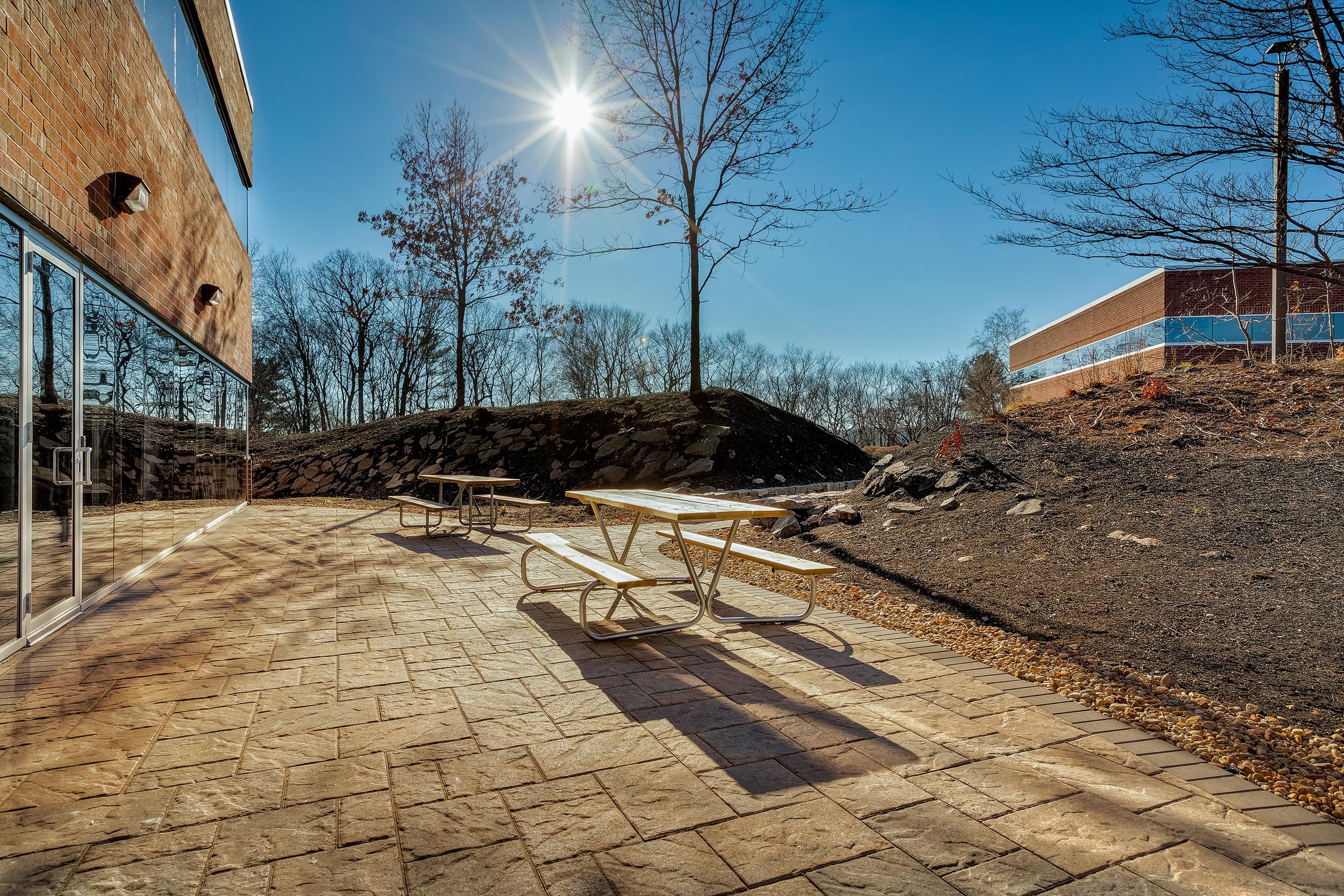 New stone patio for both 1432 & 1440 Main Street tenants to enjoy