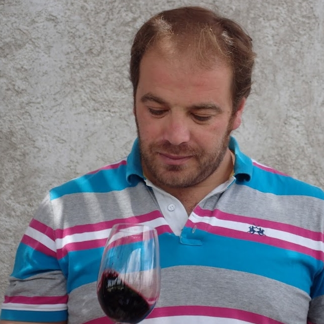 Pablo Martorell, Winemaker taste testing some of the wine.  Vina Andrico vineyard in Mendoza, Argentina.