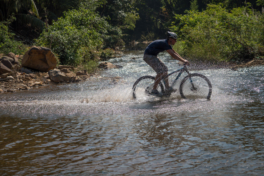 Riding through rivers in Laos