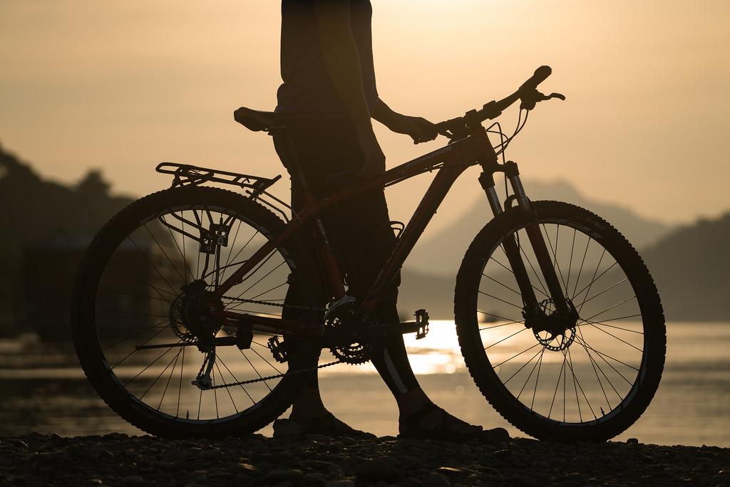 laos-biking-off-road-cycling-tour-adventure-luang-prabang-sunset-mekong-river-trail.jpg