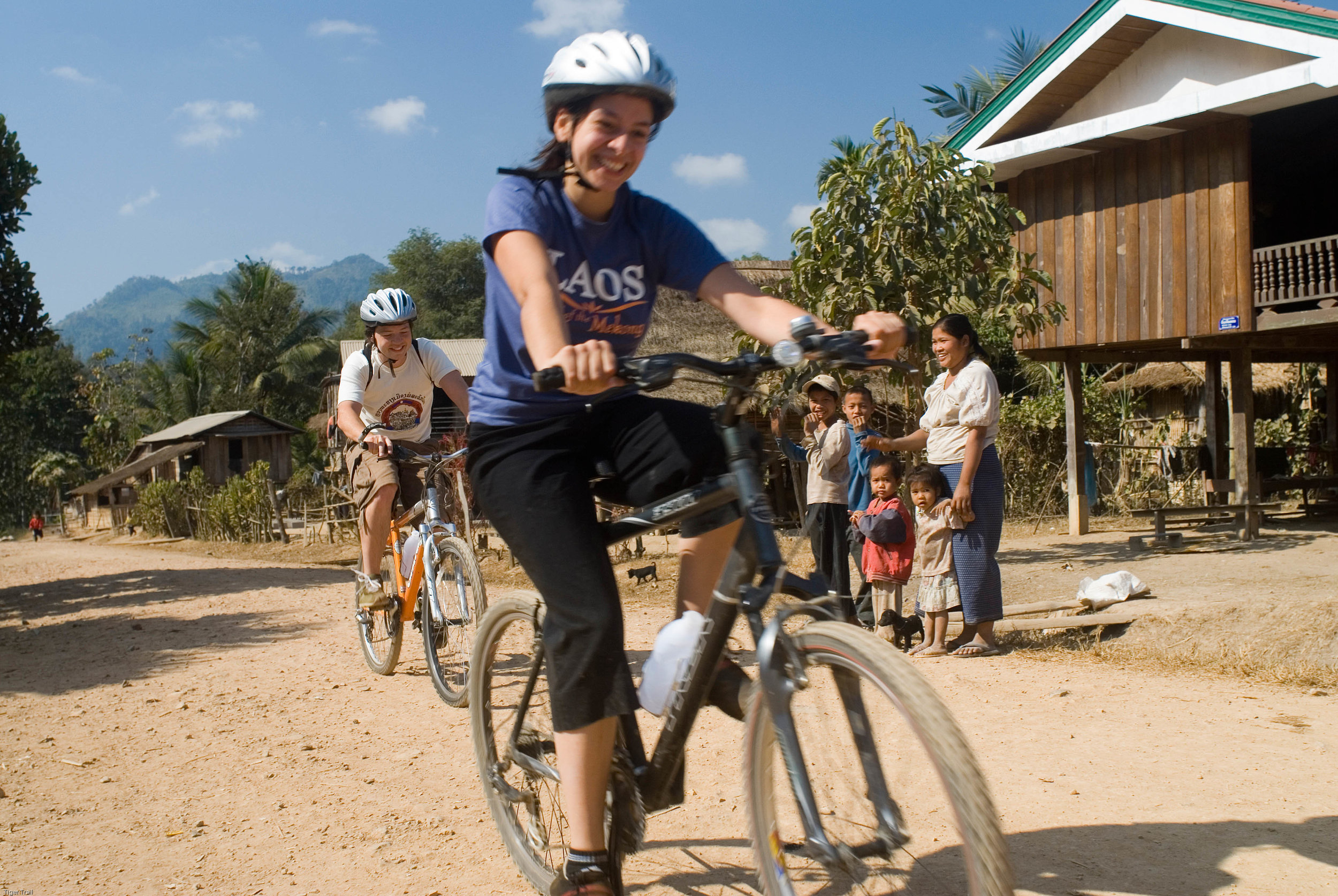 Cycling through a local village.