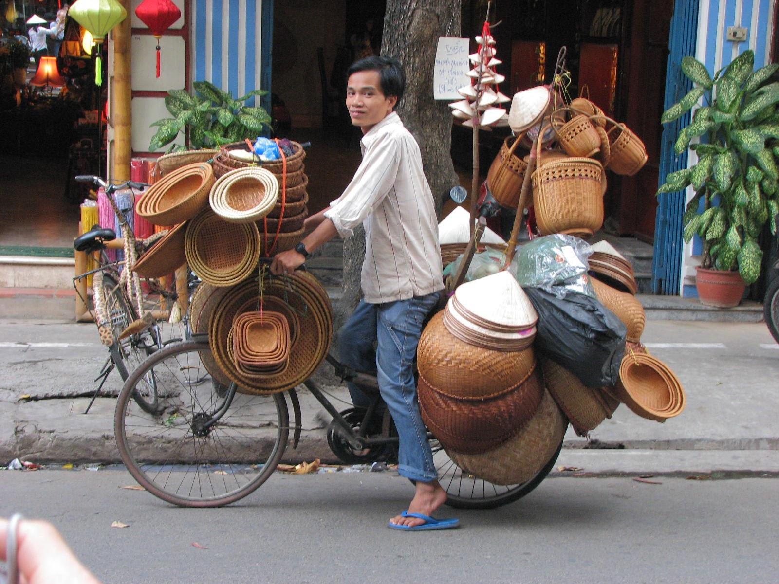 laos-mountain-biking-man-riding-bike-with-lots-of-woven-baskets-tiger-trail-039.jpg