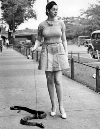 Burlesque-dancer-Zorita-walking-her-snake.png