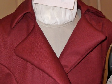 I took this snapshot halfway through the understitching process - only one lapel and one side of the collar has been under stitched, and you can see how much more nicely it lays, even without any pressing.