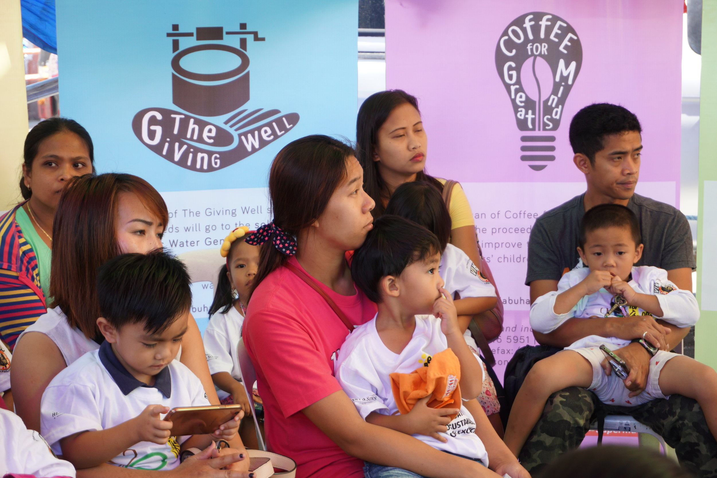 On photo:    Participating children of Brgy. Pico with their parents