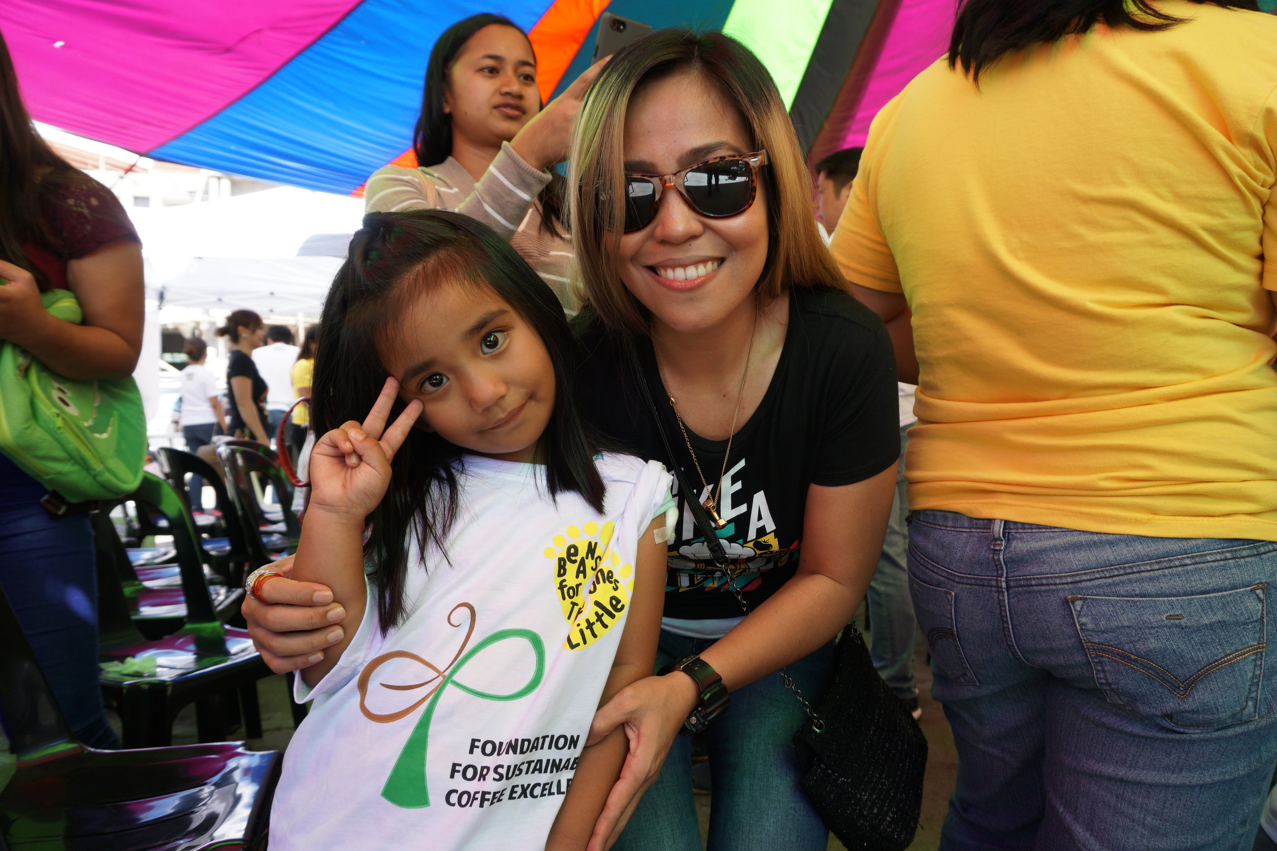 On photo:    Vikings Group Marketing Manager Raquel Bartolome poses with one of the kids
