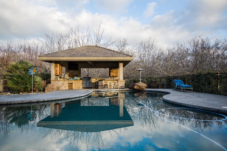 airehart-construction-durham-home-pool house-custom-beautiful-outdoor-kitchen-bar-29.jpg