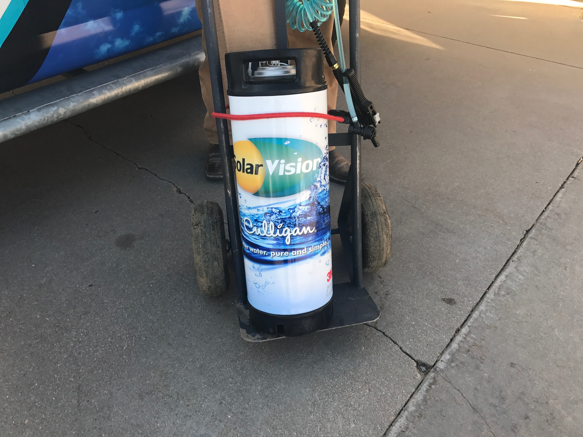 This little co-branded contraption is a pressurized water tank used for installing window film.
