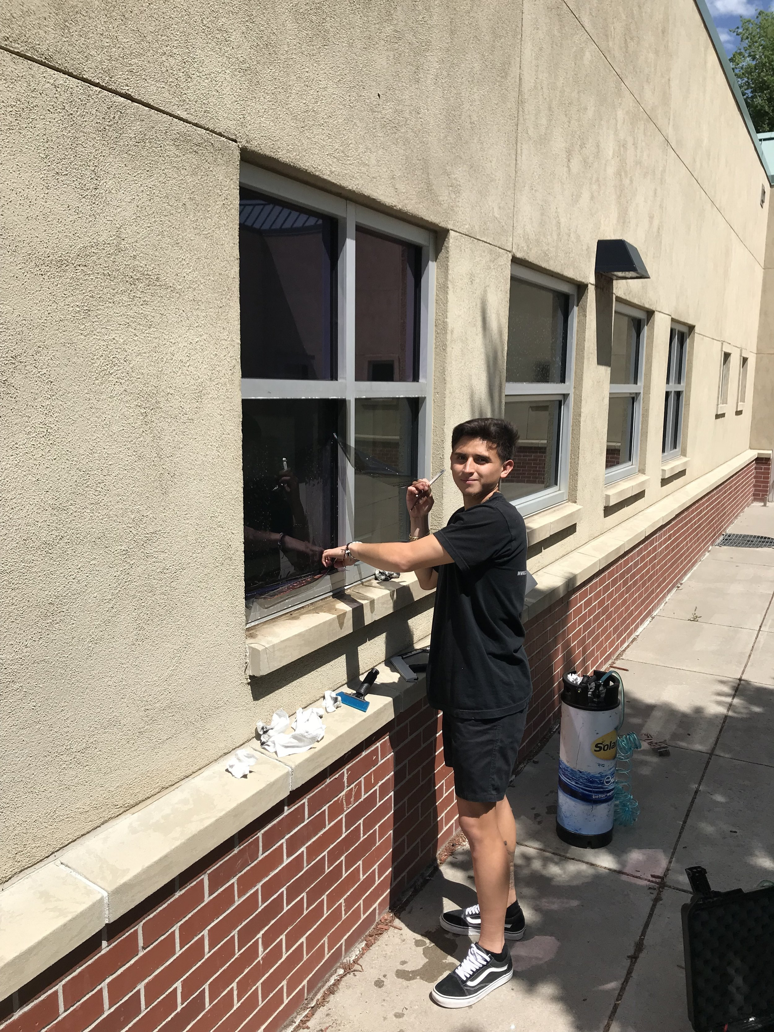 Bryan installing some exterior film. He's been with us every summer for 3 years, and has become an excellent Window Film Installer on his breaks from College.